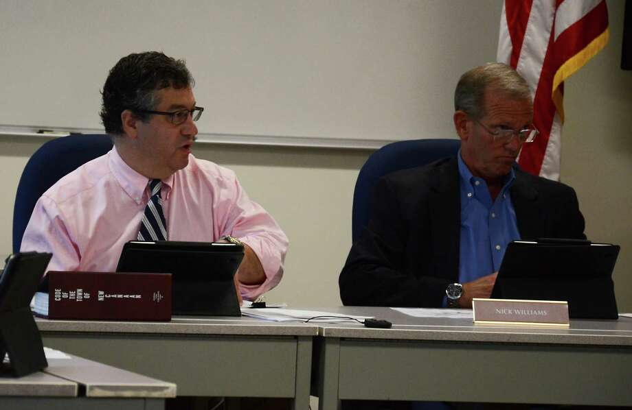Selectmen Robert Mallozzi and Nick Williams at a Board of Selectmen meeting Tuesday, June 3, 2014, at the New Canaan Police Department, in New Canaan, Conn. Mallozzi voted against awarding a bid for a wireless upgrade project at New Canaan High School adn Saxe Middle School for not having enough information. Photo: Nelson Oliveira / New Canaan News