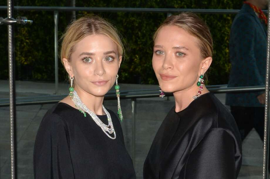 Designers Ashley Olsen (L) and Mary-Kate Olsen attend the 2014 CFDA fashion awards at Alice Tully Hall, Lincoln Center on June 2, 2014 in New York City. Photo: Andrew H. Walker, WireImage