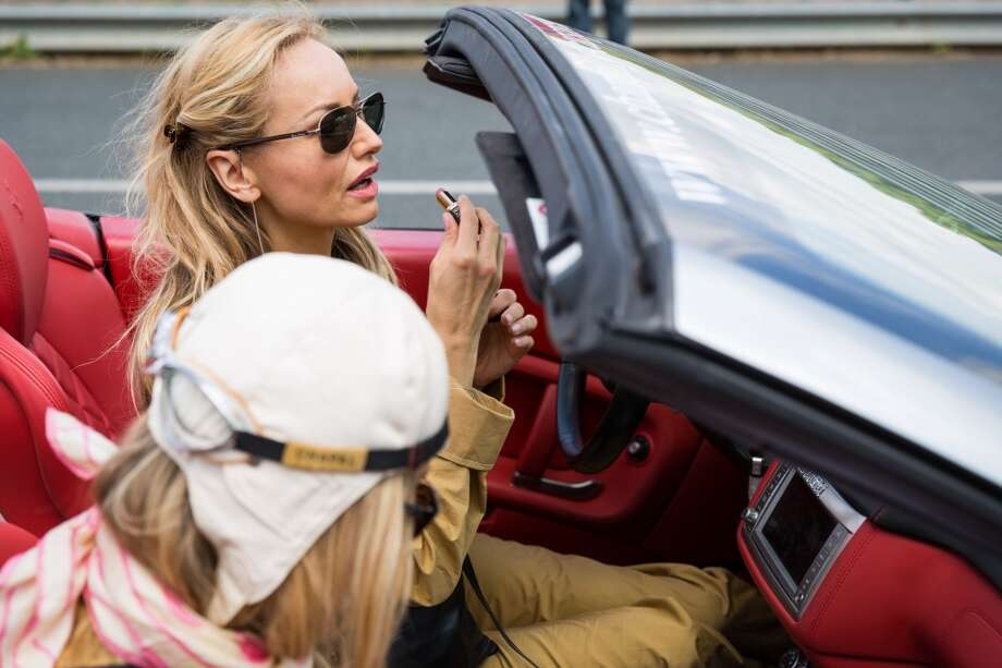 (L-R) Adriana Karembeu and her sister Natalia Sklenarikova are seen in the Ferrari California number 2 at the Circuit Maurice Tissandier during the 15th Rallye des Princesses on June 2nd, 2014 in La Chatre, France. Photo: Getty Images