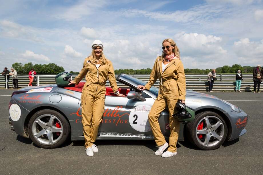 Natalia Sklenarikova and her sister Adriana Karembeu pose with the Ferrari California number 2 at the Circuit Maurice Tissandier during the 15th Rallye des Princesses on June 2nd, 2014 in La Chatre, France. Photo: Getty Images