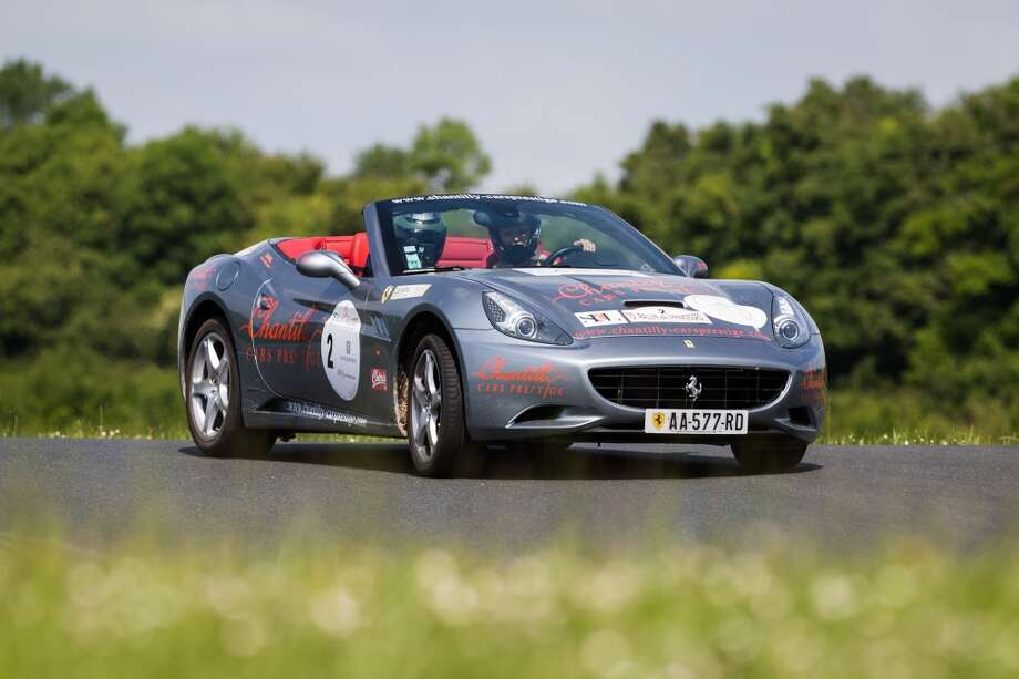 Adriana Karembeu and her sister drive the Ferrari California number 2 at Circuit Maurice Tissandier during the 15th Rallye des Princesses on June 2nd, 2014 in La Chatre, France. Photo: Getty Images