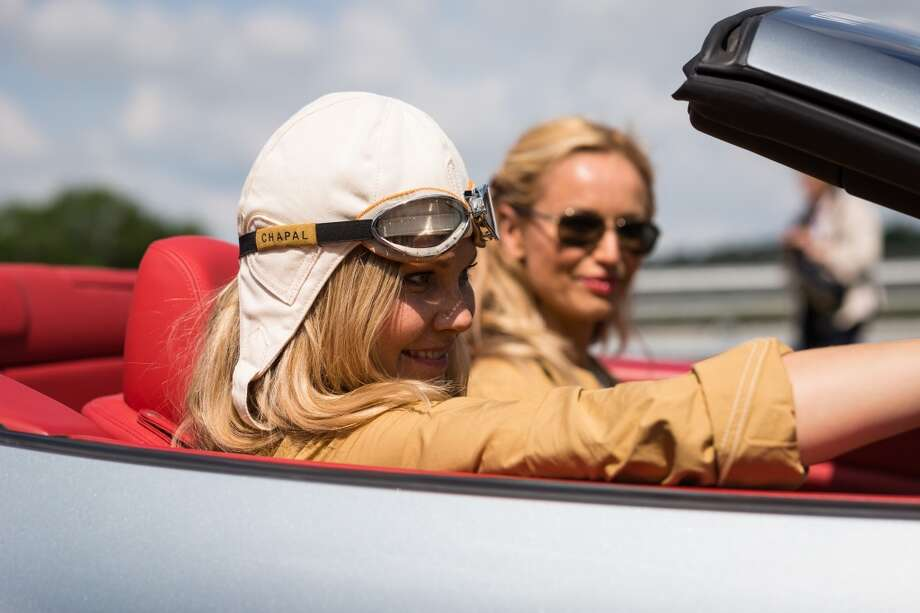 Natalia Sklenarikova and her sister Adriana Karembeu are seen in the Ferrari California number 2 at the Circuit Maurice Tissandier during the 15th Rallye des Princesses on June 2nd, 2014 in La Chatre, France. Photo: Getty Images