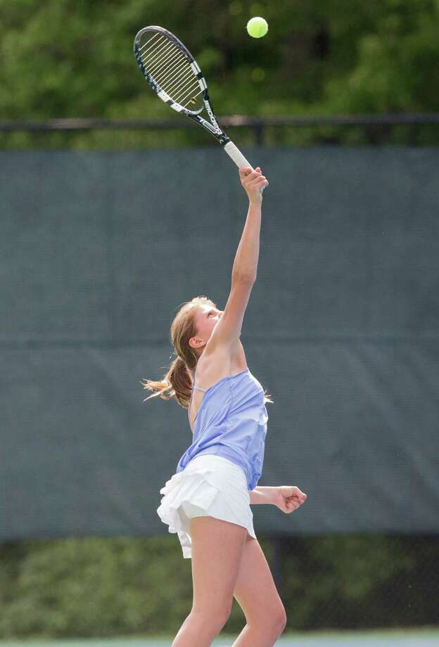 Darien's Pia Teschner serves the ball in a regular season match at New Canaan on Wednesday, May 21. Photo: Contributed Photo, Contributed / Darien News Contributed