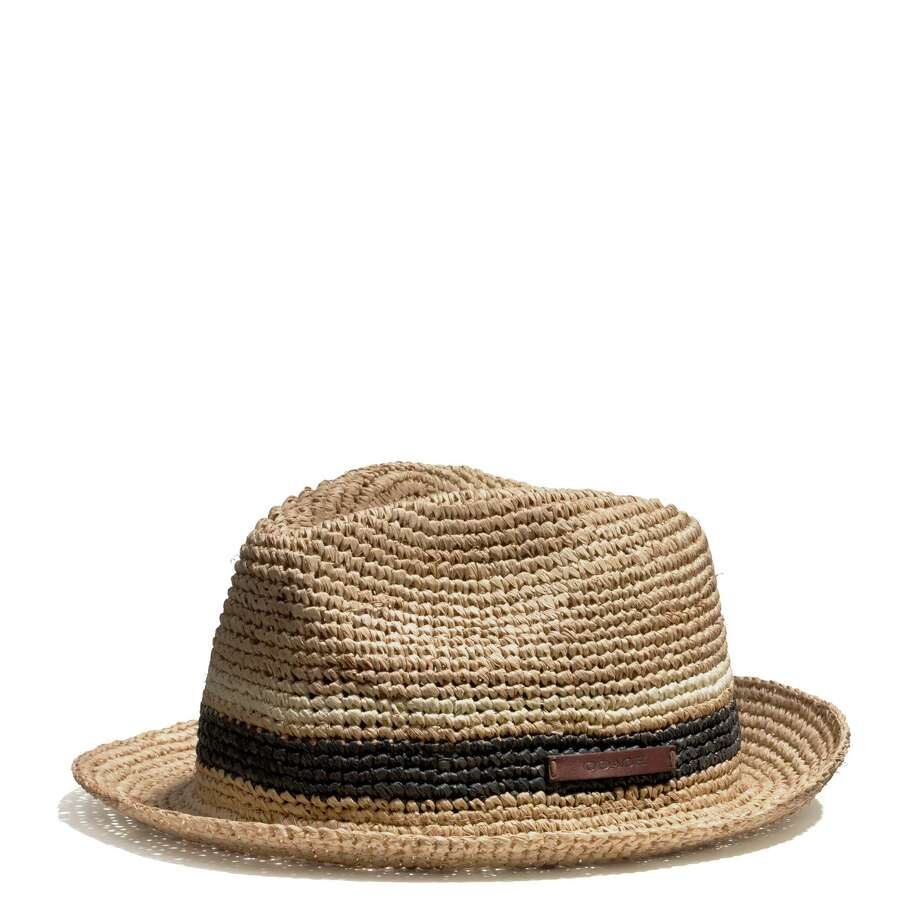 Top Hat: Summer s Beau Brummels will want a Coach Packable Straw Fedora, a rugged, raffia straw hat that keeps its shape no matter how hard you party. Stuff your crush-proof topper into your beach bag and head to the sunny shore. Comes in  salt  or  navy ; $148 at Coach stores. Photo: Coach / Coach