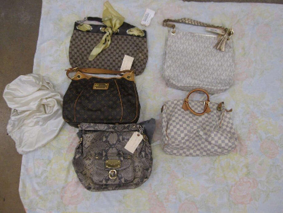 PURSES FROM DOONEY/BOURKE, HELLO KITTY, MICHAEL KORS, LOUIS VUITTON, GUCCI, ED HARDY, VICTORIA SECRET HAND BAGS Photo: San Antonio Police Department