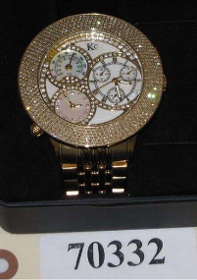 KC, GOLD COLOR MEN'S WATCH W/CLEAR STONES, +DIA, item # 70332, CS#11195997 Photo: San Antonio Police Department