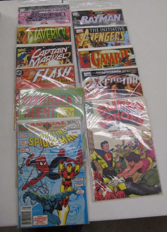 TWO BOXES W/APPROXIMATELY 200+ VINTAGE COMIC BOOKS, item # 70328, CS#12243508 Photo: San Antonio Police Department