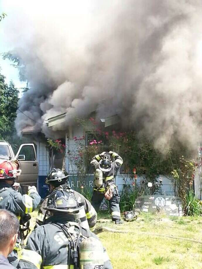 A Monday afternoon house fire killed one man and four puppies in West Seattle. (Photo by Seattle Fire Department) Photo: Seattle Fire Department