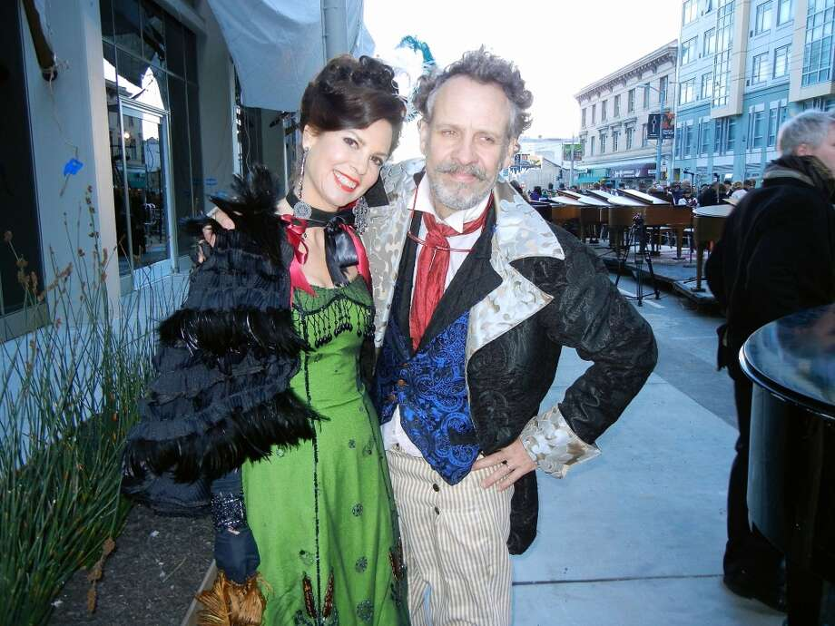 "SF Arts Commissioner Dorka Keehn and artist Brian Goggin donned period costumes to celebrate the unveiling of their work, ""Caruso's Dream,"" on Ninth Street. Feb 2014. Photo: Catherine Bigelow, Special To The Chronicle"