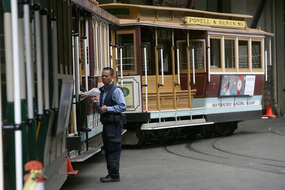 SAN FRANCISCO, CA - JUNE 03:  Cable Cars sit idle at the historic Cable Car Barn and Powerhouse on June 3, 2014 in San Francisco, California. For the second day in a row, San Francisco commuters are facing long delays as San Francisco Municipal Transit Agency (MUNI) transit workers continue a sickout to protest against a rejected labor contract. More than half of the city's buses and trains are out of service and the famed San Francisco Cable Cars are not running.  (Photo by Justin Sullivan/Getty Images)