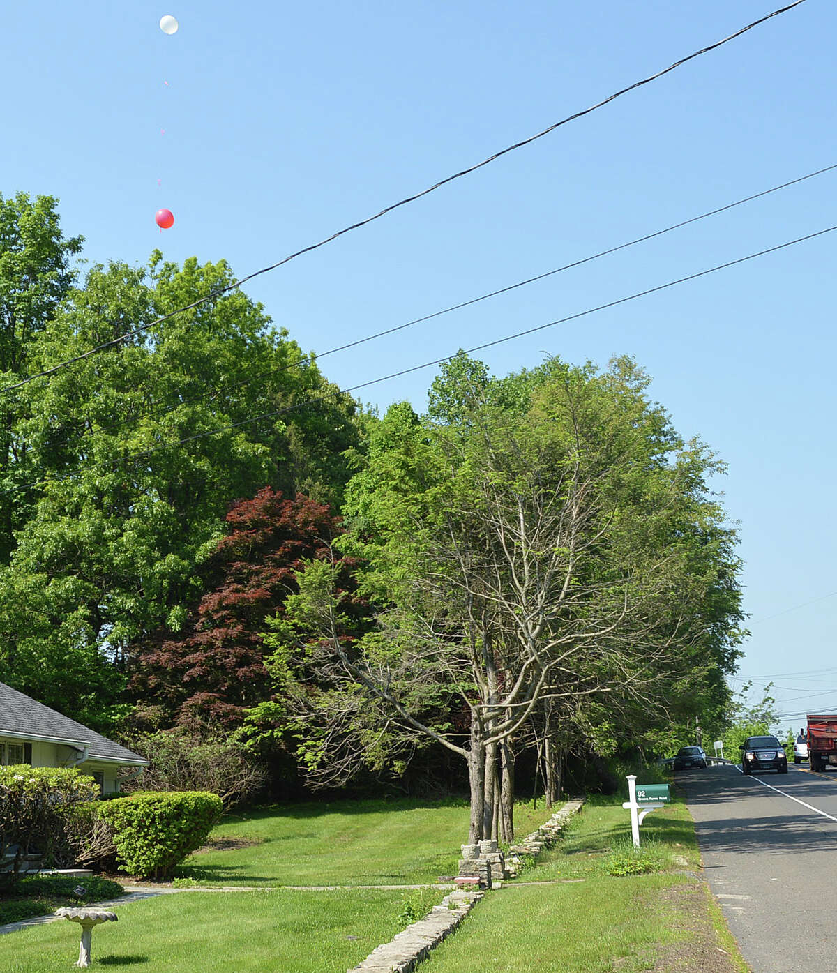 Two balloons float over 92 Greens Farms Road to illustrate the height of a cell phone tower proposed for the property.