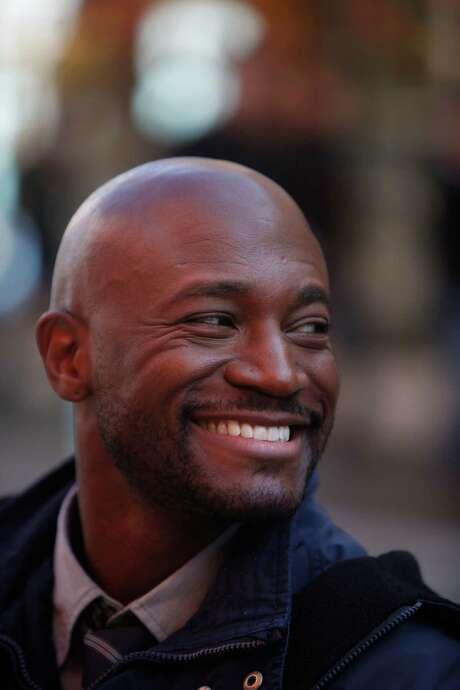 "Actor Taye Diggs smiles as he works on the set of  TNT's ""Murder in the First"" while shooting a scene in San Francisco's Chinatown district on Monday, March 24, 2014, in  San Francisco, Calif. Photo: Lea Suzuki, Staff / ONLINE_YES"
