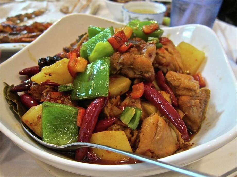 The Big Plate Chicken at Xin Jiang BBQ is a tasty, homey stew. Photo: Alison Cook / ONLINE_YES