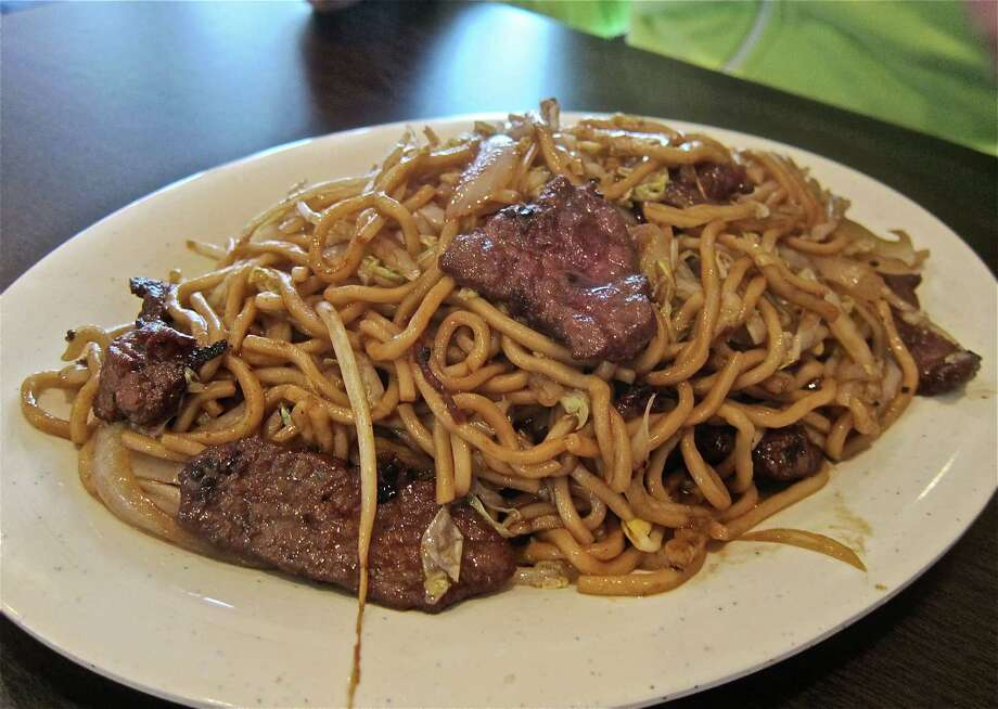 Stir-fried noodles with beef at Xin Jiang BBQ. Photo: Alison Cook / ONLINE_YES