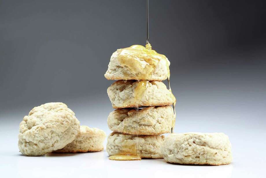 These biscuits, with honey, puffed up high and browned golden. Photo: James Nielsen, Staff / © 2014  Houston Chronicle