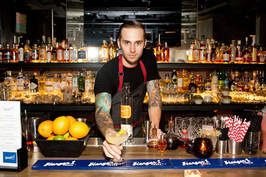 Bartender Max Alexander makes a Going Rogue signature cocktail using Hangar 1 Vodka during the San Francisco Chronicle's Top 100 party at Dirty Habit   in San Francisco, Calif., Monday, June 2, 2014. Photo: Jason Henry, Special To The Chronicle