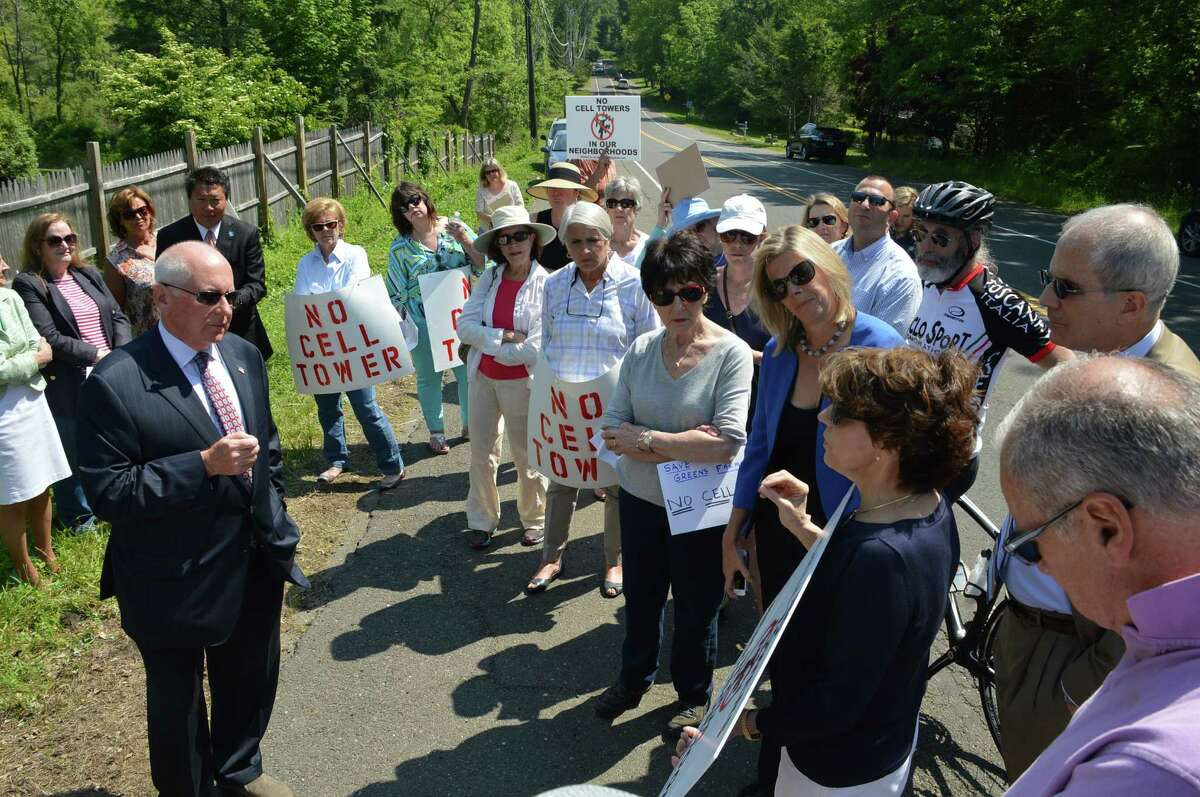 First Selectman Jim Marpe discusses concerns with group protesting plans to erect a cell phone tower Tuesday morning.
