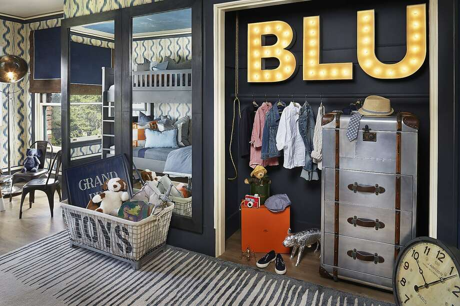 "A guy thing: Marin designer Shelley Cahan turned a boy's bedroom into a ""little gentleman's quarter"" for this year's Decorator Showcase. Cahan used shades of blue and gray and added pops of persimmon for warmth. Tailored elements combine with vintage accents and distressed furnishings for a classic look. Photo: Peter Medilek"
