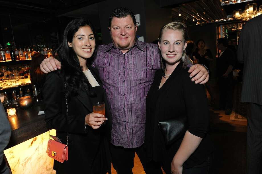 The San Francisco Chronicle celebrated their choice of the top 100 Bay Area restaurants at the Dirty Habit in San Francisco on June 2, 2014. From left are: Jessica Schultz, Proximo Spirits, Jeff Gust and Caley Shoemaker. Photo: Susana Bates, Special To The Chronicle