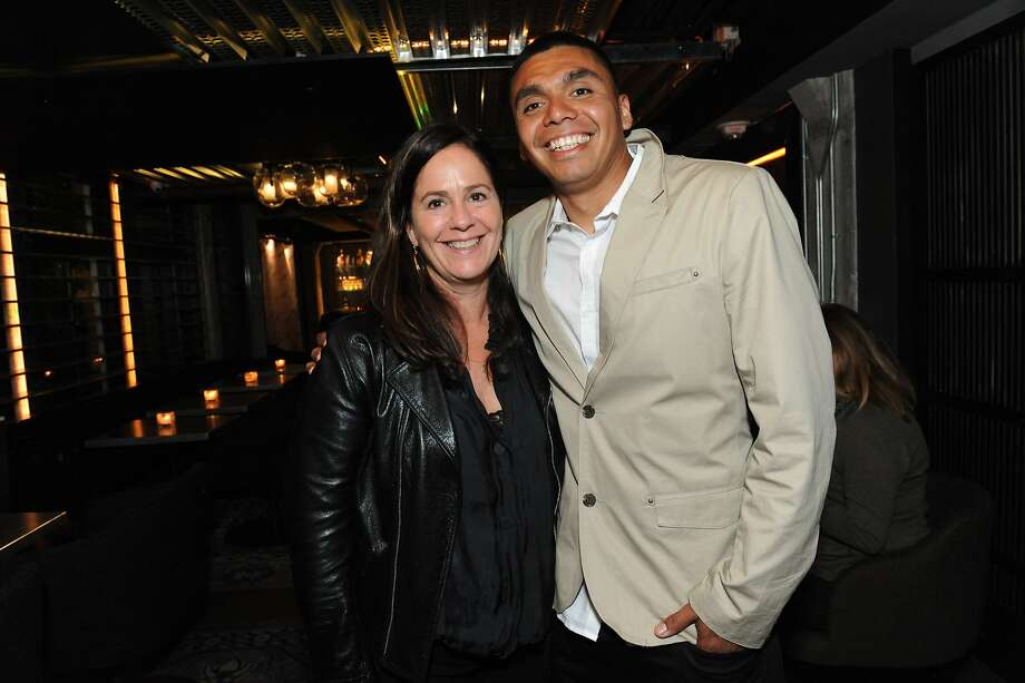 The San Francisco Chronicle celebrated their choice of the top 100 Bay Area restaurants at the Dirty Habit in San Francisco on June 2, 2014. From left are: Bettina Rouas and Rojelio Garcia from Angele Restaurant. Photo: Susana Bates, Special To The Chronicle