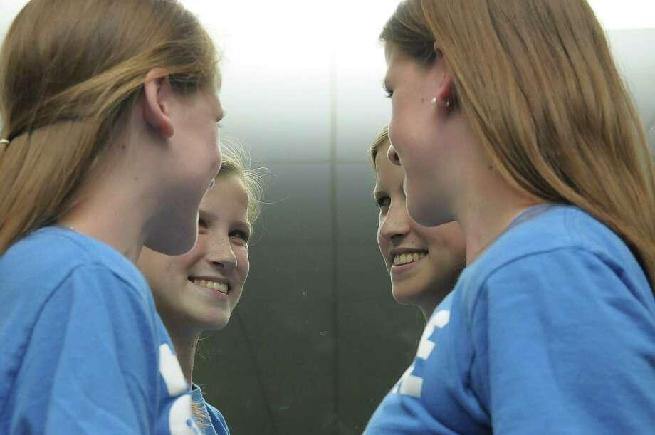 Emily and Caitlin Copeland are reflected in a mirror at Lutheran High North Wednesday, May 14, 2014. Photo: Â Tony Bullard 2014, Freelance Photographer / © Tony Bullard & the Houston Chronicle