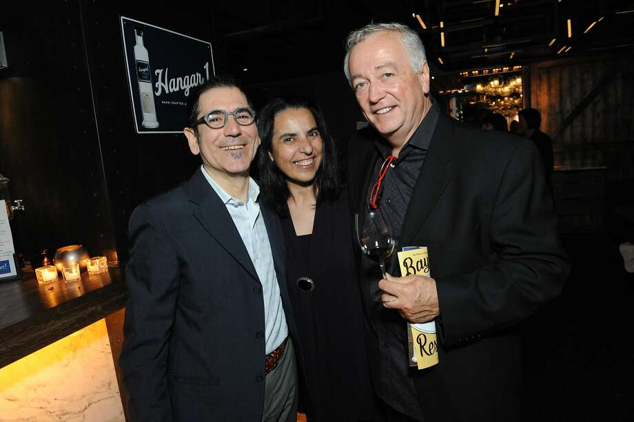 The San Francisco Chronicle celebrated their choice of the top 100 Bay Area restaurants at the Dirty Habit in San Francisco on June 2, 2014. From left are Massimiliano Conti and Lorella Degan of La Ciccia Restaurant, and Roland Passot of La Folie. Photo: Susana Bates, Special To The Chronicle