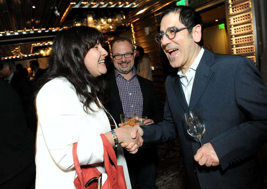 The San Francisco Chronicle celebrated their choice of the top 100 Bay Area restaurants at the Dirty Habit in San Francisco on June 2, 2014. From left are: Julia Weinberg, Jon Bonne from SFChronicle and La Ciccia chef-owner Massimiliano Conti Photo: Susana Bates, Special To The Chronicle