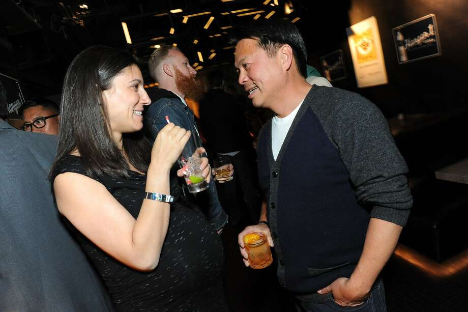 The San Francisco Chronicle celebrated their choice of the top 100 Bay Area restaurants at the Dirty Habit in San Francisco on June 2, 2014. From left are SFChronicle's Amanda Gold and Chef/Owner of Slanted Door Charles Phan. Photo: Susana Bates, Special To The Chronicle