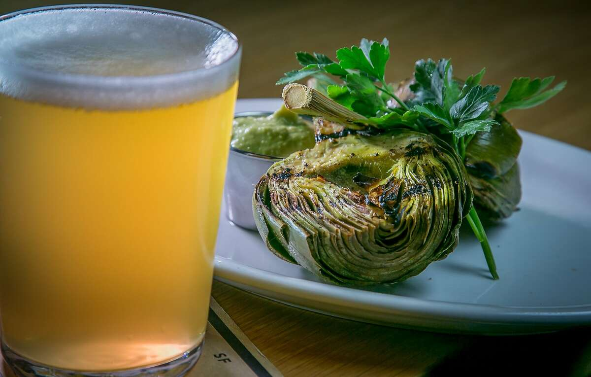 The Mikkeller Wit and the grilled Artichoke at Mikkeller in San Francisco, Calif., is seen on Saturday, May 24th, 2014.