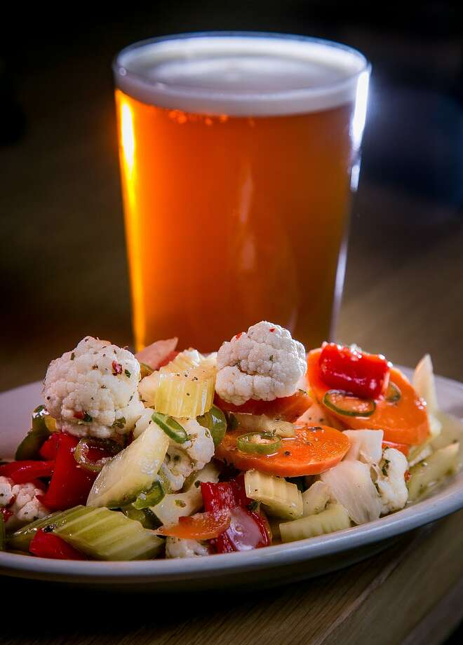 A Tenderloin IPA makes a smart companion to the spicy giardiniera at Mikkeller Bar on Mason Street near Turk. Photo: John Storey, Special To The Chronicle