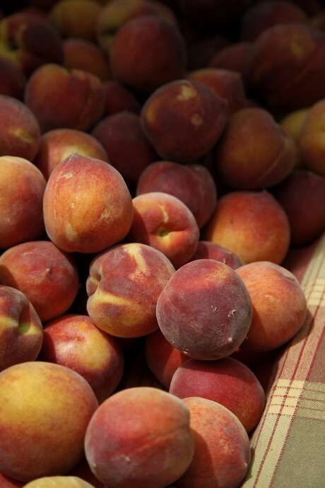 The season for peaches, and other stone fruits, is early this year because of warm weather. Photo: Preston Gannaway, Special To The Chronicle