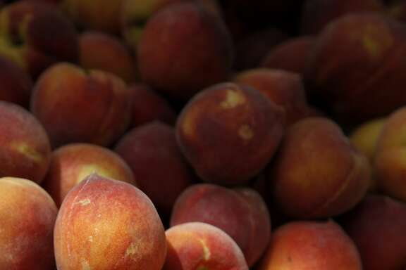 Cipponeri Family Farms' peaches on display at the weekly farmer's market in Carmel-by-the-Sea, Calif., on Thursday, May 22, 2014.