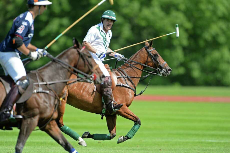 Greenwich resident Peter Brant leads his White Birch team during opening day action at the Greenwich Polo Club on Sunday, June 1, 2014. Photo: Contributed Photo, John Ferris Robben/Contributed P / Greenwich Time Freelance  John Ferris Robben