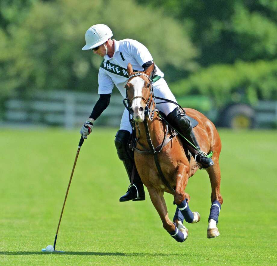 A White Birch rider controls the ball during opening match action at the Greenwich Polo Club on Sunday, June 1, 2014. Photo: Contributed Photo, John Ferris Robben/Contributed P / Greenwich Time Freelance  John Ferris Robben