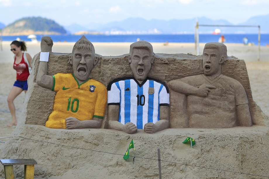 How dare you give me a yellow card?! A sand sculpture on Copacabana beach in Rio de Janeiro portrays an angry trio - Neymar of Brazil, Lionel Messi of Argentina and Cristiano Ronaldo (sans shirt) of Portugal. Photo: Hassan Ammar, Associated Press
