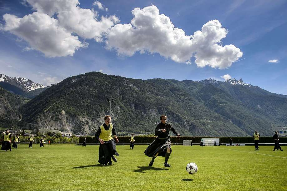 X men of the Alps: In Riddes, Switzerland, seminarians in cassocks relax with a soccer match after a week of prayer and study at the International Seminary of Saint Pius X. Photo: Fabrice Coffrini, AFP/Getty Images