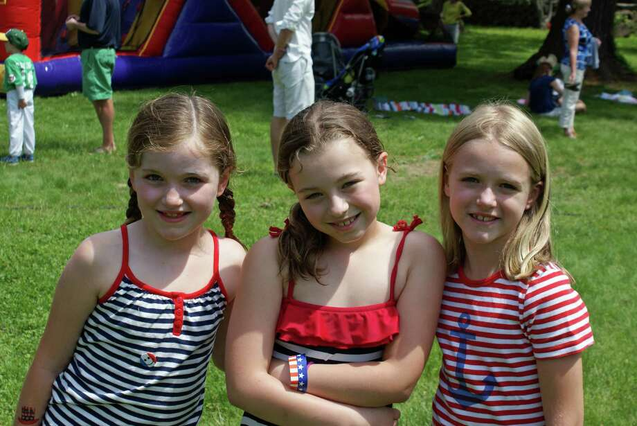 Celia Parkhill, Avery Laird and Parker Hanson celebrate Memorial Day at First Presbyterian Church's barbecue Monday, May 26. Photo: Contributed Photo, Contributed / New Canaan News Contributed