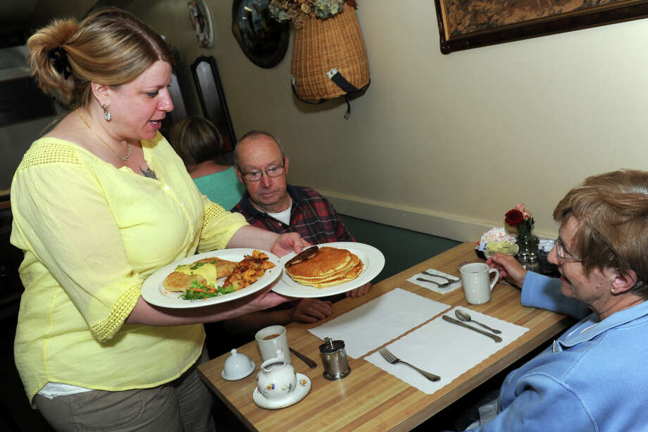 Michelle Lebel serves breakfast to Charles and Louise Dickerson, of Ansonia, at the Corner Restaurant, in Milford, Conn. June 3, 2014. Photo: Ned Gerard / Connecticut Post