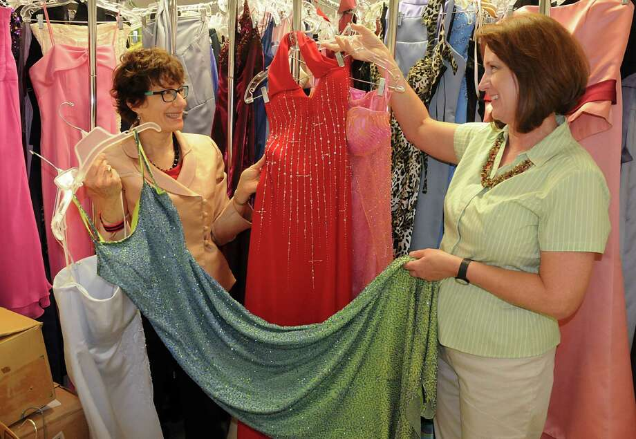 Elise Sheppard, left, a River Oaks-area resident who is librarian for Lone Star College-Cypress Library, has spent 10 years collecting donated prom dresses to give girls who could not afford one. Recently, she and volunteer Anne Criddle, right, were busy with the happy task of finding the perfect dresses and shoes for high school seniors' big dance. But the need for dresses has increased, and Sheppard is hoping for more donations. Photo: David Hopper, Freelance / freelance