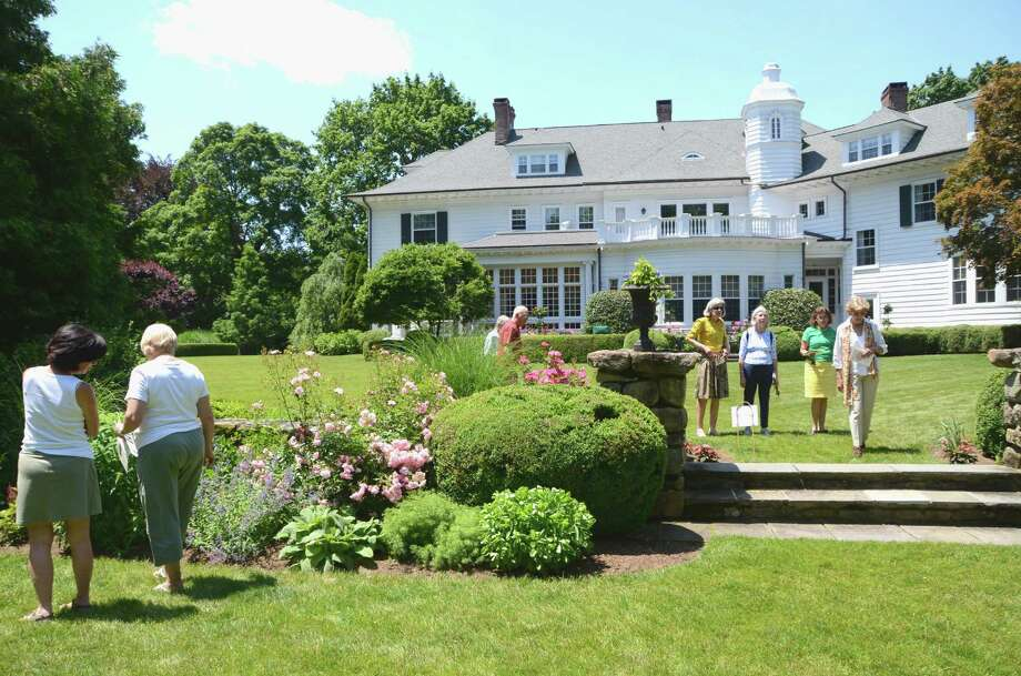 The New Canaan Nature Center's Secret Garden Tour will celebrate its 25th anniversary on Friday, June 6. Above, the tour stopped at a Smith Ridge home during the 2012 event. Photo: Jeanna Petersen Shepard / New Canaan News
