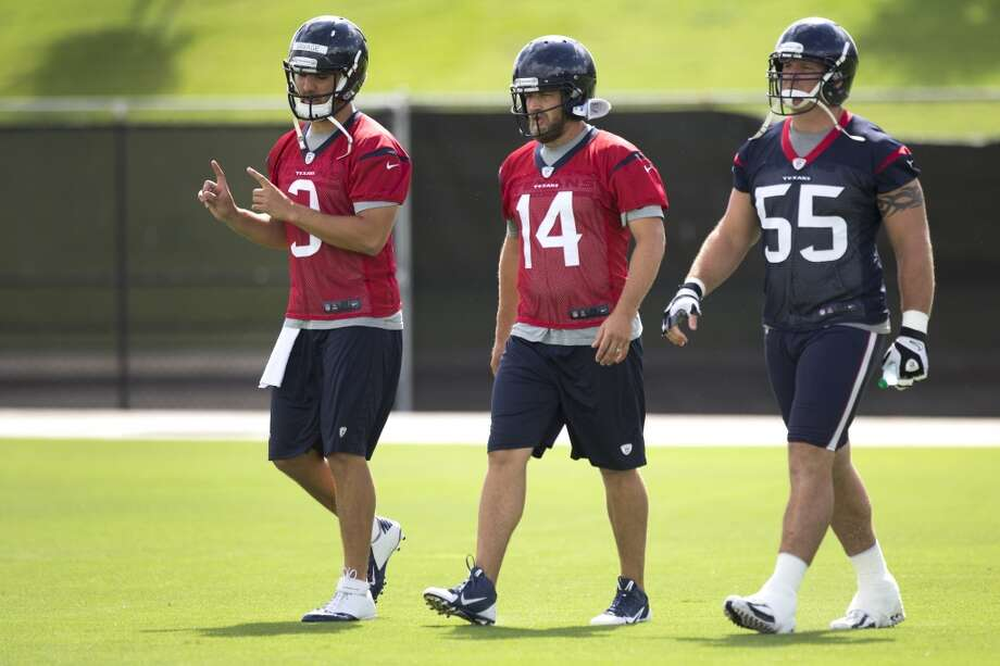Day 5 - June 3  Texans quarterbacks Tom Savage (3) and Ryan Fitzpatrick (14) walk onto the field with center Chris Myers (55). Photo: Brett Coomer, Houston Chronicle