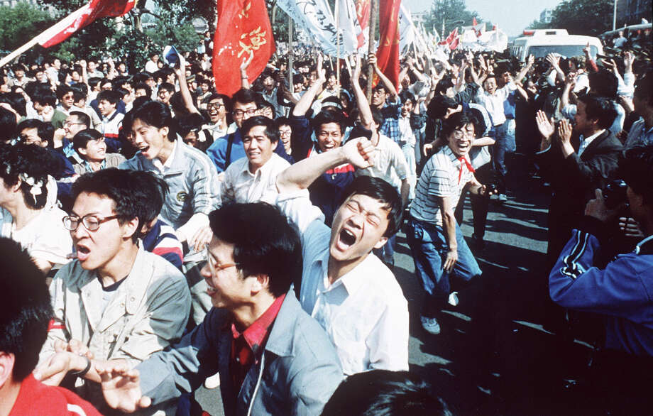 Chinese students shout after breaking through a police blockade during a pro-democracy march to Tiananmen Square, Bejing, May 4 1989. Photo: S.MIKAMI, AP / 1989 AP