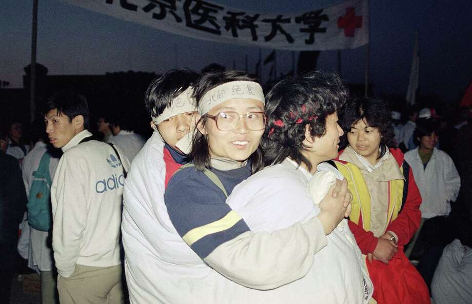 Striking Beijing University students crowd three to a bag during the chilly night sit in Beijing's Tiananmen Square, Monday, May 15, 1989. They are in their third day of a strike for democracy. Photo: Sadayuki Mikami, AP / 1989 AP