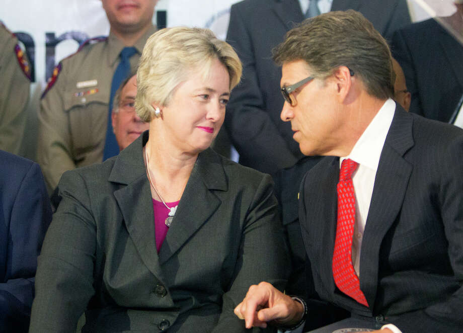 Mayor Annise Parker, left, and Governor Rick Perry talk before a news conference at City Hall announcing an Anti-human trafficking campaign, Tuesday, June 3, 2014, in Houston. Photo: Cody Duty, Houston Chronicle / © 2014 Houston Chronicle