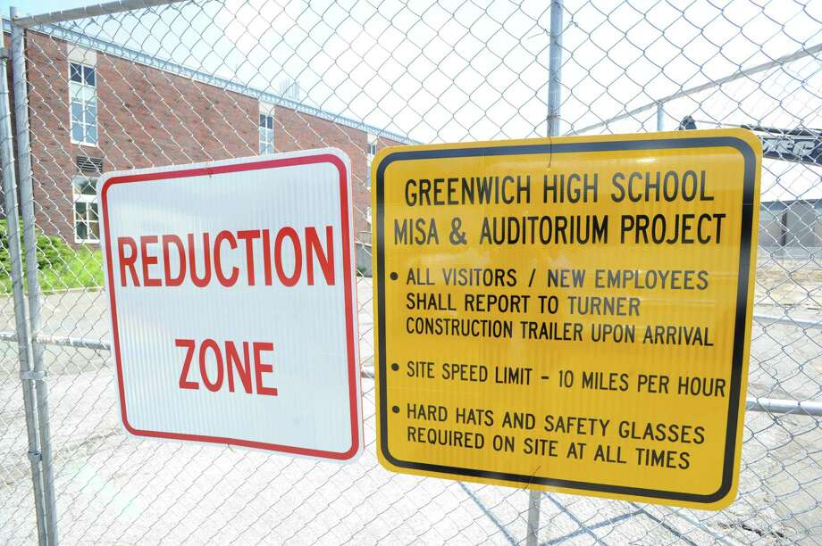 Signs on a fence in the construction zone for Greenwich High School music instruction space and auditorium project at the school, Tuesday afternoon, July 16, 2013. Photo: Bob Luckey / Greenwich Time