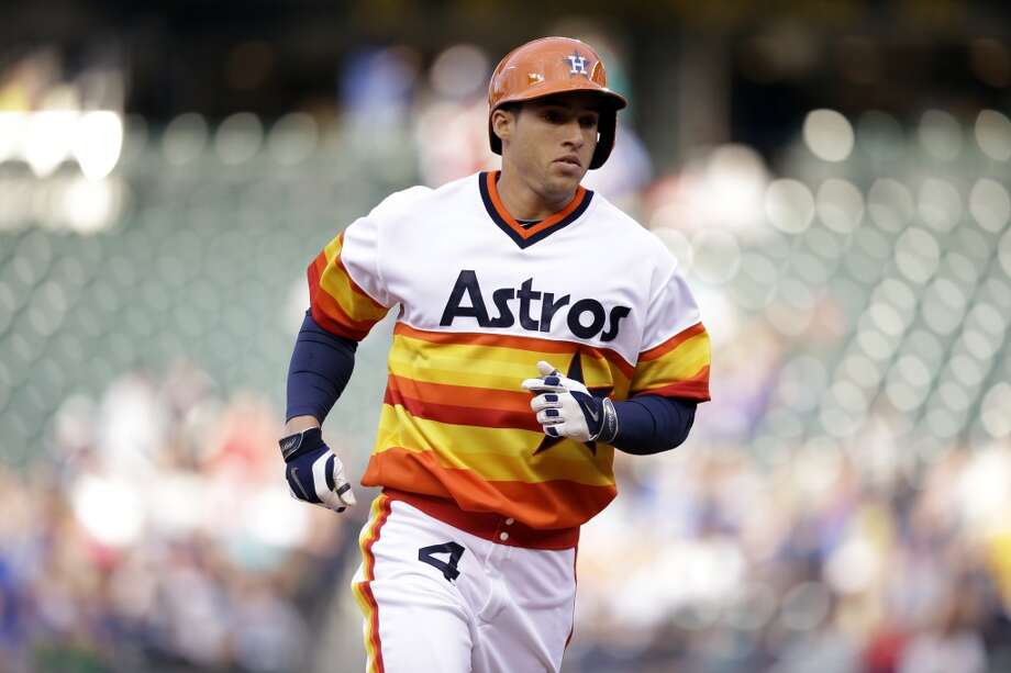 George Springer rounds the bases after hitting a home run. Photo: Elaine Thompson, Associated Press