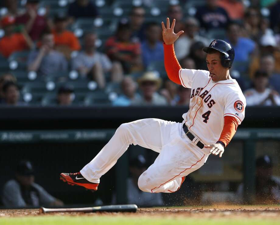 George Springer dives into home to score on a single hit by Dexter Fowler in the seventh inning. Photo: Karen Warren, Houston Chronicle