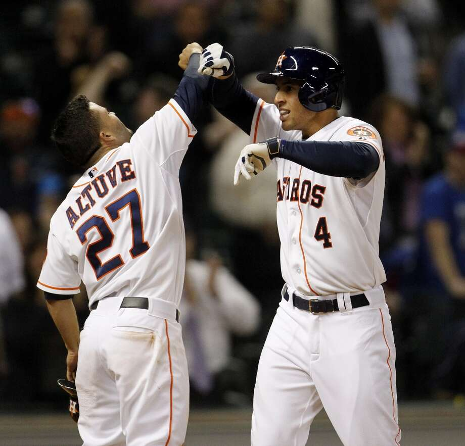 George Springer (4) celebrates his game-tying, two-run home run with Jose Altuve (27) during the seventh inning of an MLB game at Minute Maid Park, Wednesday, May 14, 2014, in Houston. ( Karen Warren / Houston Chronicle Photo: Karen Warren, Houston Chronicle