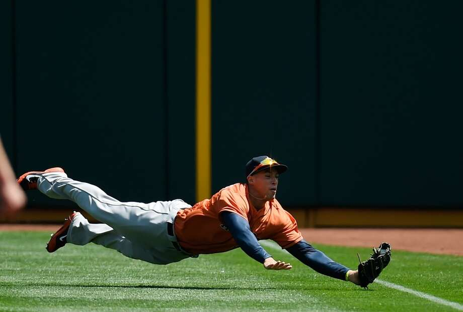 George Springer makes a diving catch to rob Athletics' Coco Crisp of a hit on April 20, 2014. Photo: Thearon W. Henderson, Getty Images