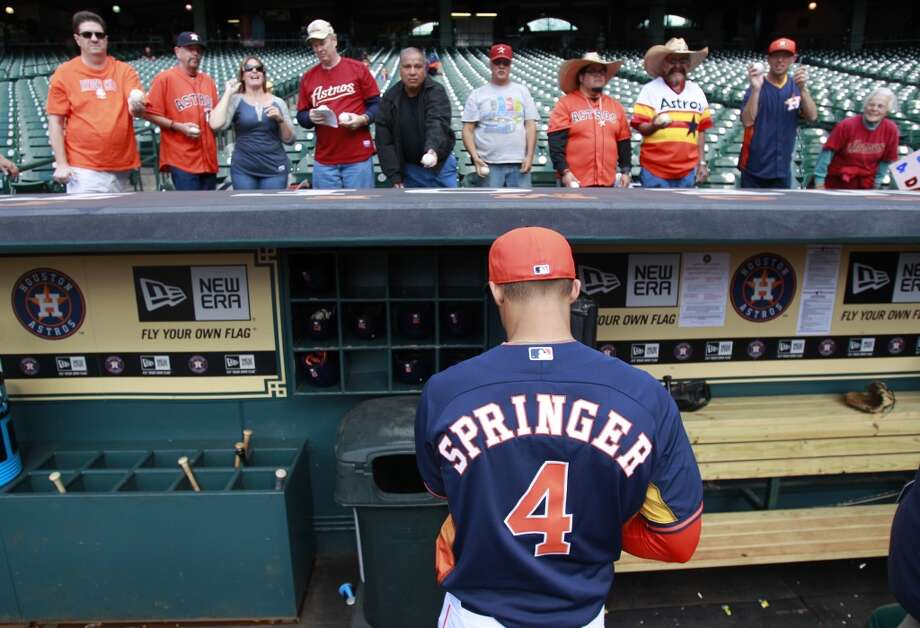 George Springer signs autographs before his first MLB game. Photo: Melissa Phillip, Houston Chronicle